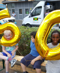 image-Children residents with 50 balloons crop.png